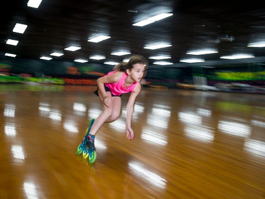 Torrie Weber, 10, skates around the rink at Weber's Skate World in Milton on Monday. The skating rink's grand opening is set for Friday.