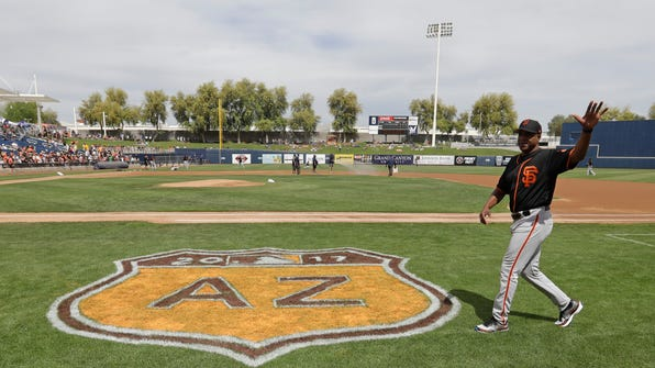San Francisco Giants' Barry Bonds waves to fans before a spring training baseball game against the Milwaukee Brewers, Wednesday, March 22, 2017, in Phoenix. (AP Photo/Darron Cummings)
