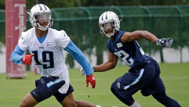 Titans wide receiver Tajae Sharpe runs a drill against cornerback Kalan Reed during practice June 15.