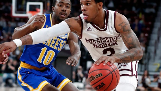Mississippi State guard Lamar Peters (2) dribbles past McNeese State guard Jarren Greenwood (10) during the first half of an NCAA college basketball game in Starkville, Miss., Tuesday, Dec. 4, 2018. Mississippi State won 90-77. (AP Photo/Rogelio V. Solis)