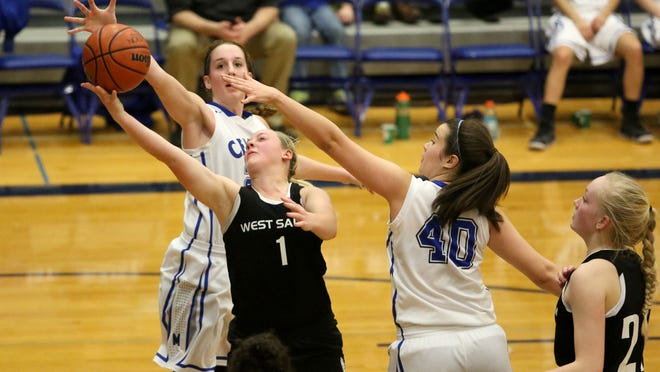 West Salem's Maddie Hopper (1) takes a shot under pressure from McNary defenders Lauren Hudgins (40) and Kaelie Flores during their game on Tuesday, in Keizer.