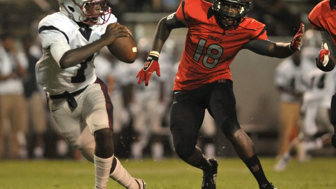 Park Crossing quarterback Malik Cunningham scrambles away from Dothan's Ed Jones on Thursday.