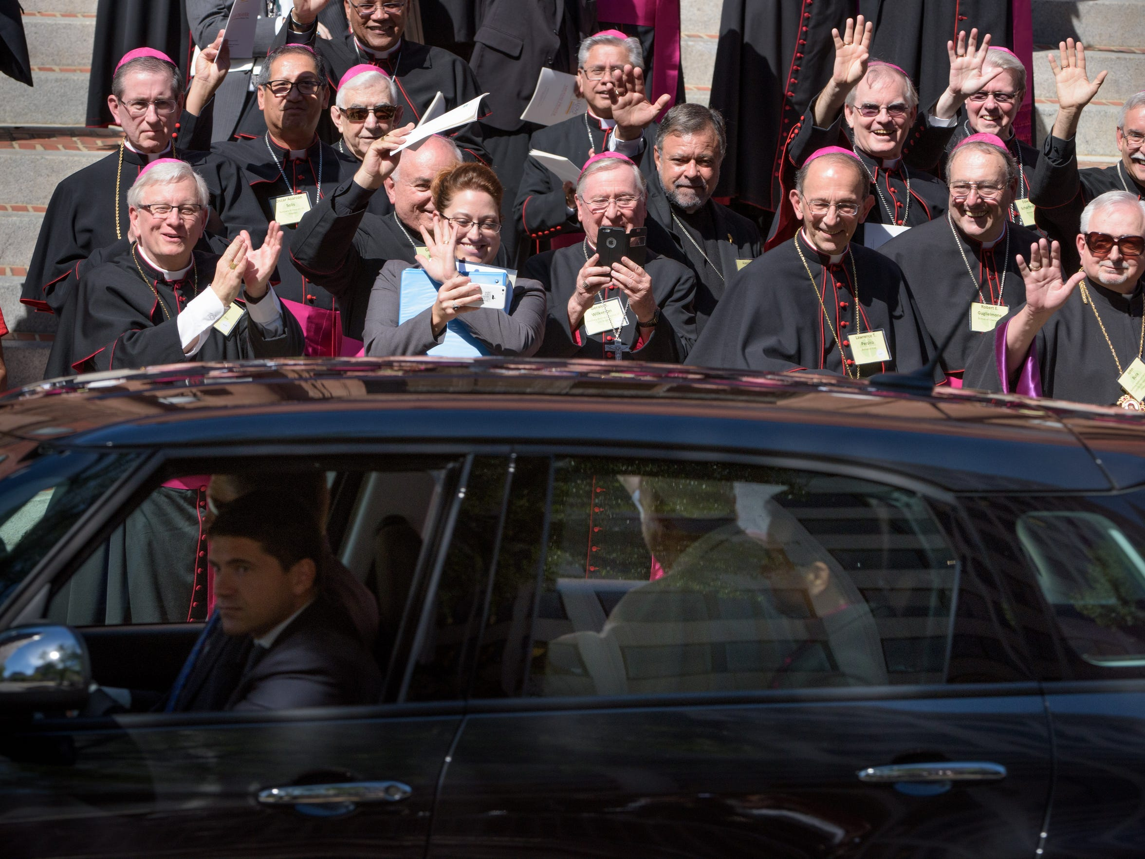 Green Bay Bishop David Ricken, front left, and others say goodbye to Pope Francis before he leaves in a vehicle outside Cathedral of St. Matthew the Apostle in Washington, D.C., after the pontiff had a prayer gathering with U.S. bishops Wednesday.
