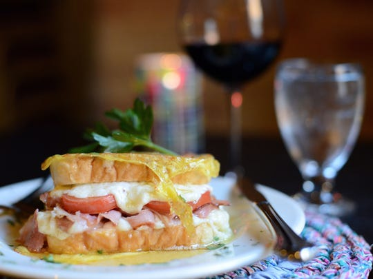 The Italian Christo with prosciutto, ham, tomato and mascarpone and mozzarella cheese on Texas bread dipped in egg batter, grilled and then drizzled with honey.