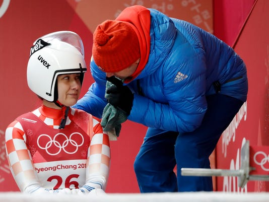 Daria Obratov of Croatia sales at her coach before she starts her first run during the women's luge competition at the 2018 Winter Olympics in Pyeongchang, South Korea, Monday, Feb. 12, 2018. (AP Photo/Andy Wong)
