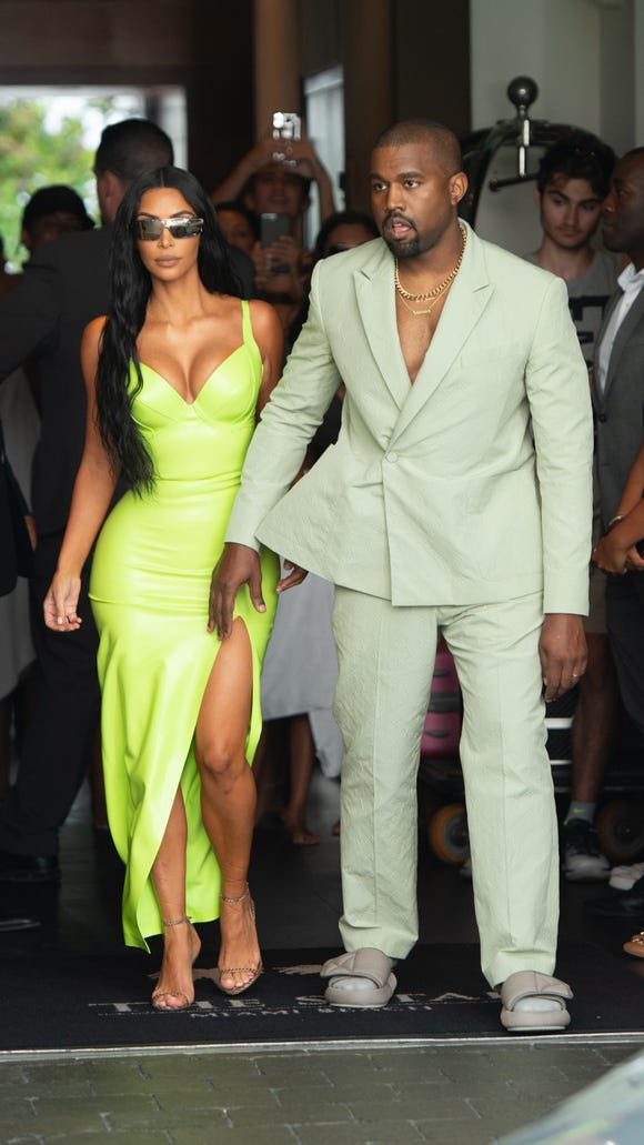 Kim Kardashian and Kanye West light up 2 Chainz\'s wedding with neon