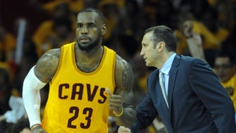 Cleveland Cavaliers forward LeBron James (23) is congratulated by head coach David Blatt after making a shot during the third quarter against the Atlanta Hawks in game four of the Eastern Conference Finals of the NBA Playoffs at Quicken Loans Arena.