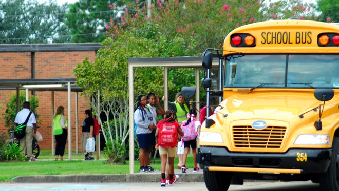 Buses drop students off at L.J. Alleman Middle School.