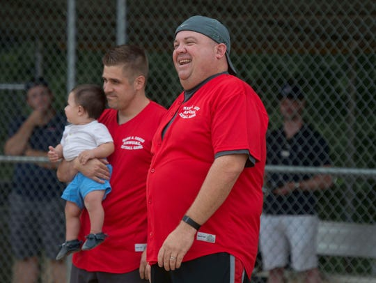 Chris Carlin, right, at charity softball game in 2015.