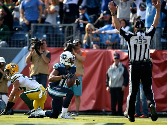 Titans wide receiver Rishard Matthews (18) catches