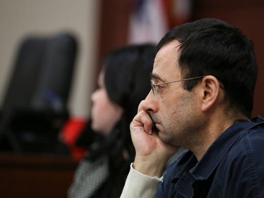 Larry Nassar listens to victim impact statements on Tuesday, Jan. 16, 2018, during  the first day of his sentencing in Circuit Court Judge Rosemarie Aquilina's circuit courtroom. The sentencing will take four days to allow nearly 100 statements.