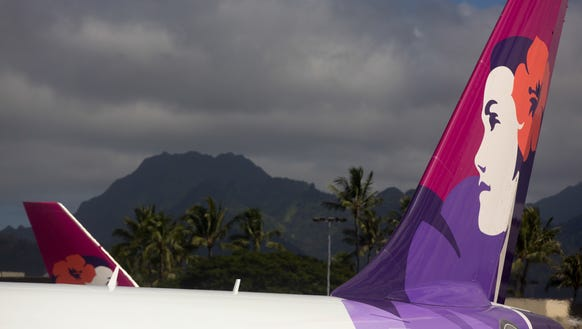 Despite clouds in the distance, a Hawaiian Airlines