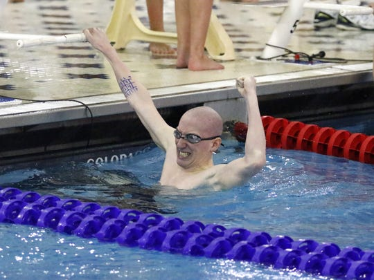 Noah Brizzolara of Maine-Endwell reacts after he won the 200 freestyle in a state qualifying time Saturday at the Section 4 Class B championship meet at Owego.