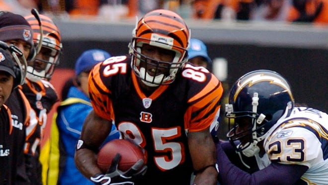 Cincinnati Bengals receiver Chad Johnson (85) is pushed out-of-bounds by San Diego Chargers cornerback Quentin Jammer (23) after catching a pass in their NFL football game, Sunday, Nov. 12, 2006, in Cincinnati. Johnson caught 11 passes for 260 yards, a Bengals team record, in the game won by the Chargers, 49-41. (AP Photo/David Kohl) ORG XMIT: PBS116