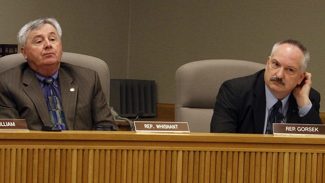 Rep. Gene Whisnant, R-Sunriver, listens to testimony at a public hearing.