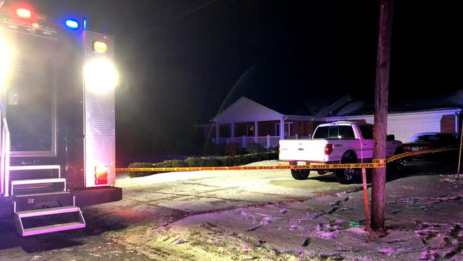 The scene outside a home a the 11000 block of East 191st Street, just east of Noblesville, where three people were found dead inside on Christmas.