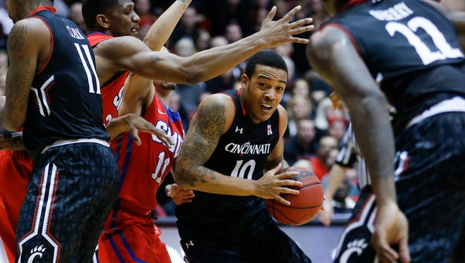 Cincinnati Bearcats guard Troy Caupain (10) drives to the basket in the second half during the NCAA basketball game between the Southern Methodist Mustangs and the Cincinnati Bearcats, Sunday, March 6, 2016, at Fifth Third Arena in Cincinnati. Cincinnati defeated SMU 61-54.