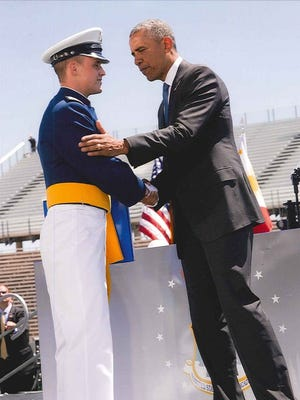 Second Lt. Carson H. Lomas is being congratulated by President Barack Obama at the USAFA graduation on June 2.