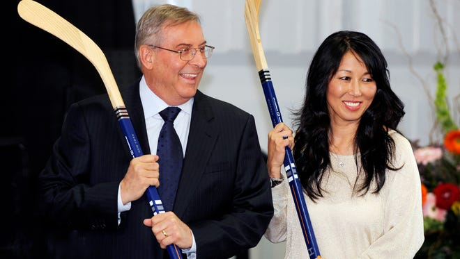 In this April 13, 2013, file photo, Buffalo Sabres' owner Terry Pegula and his wife, Kim Pegula, pose for cameras during groundbreaking ceremonies at  First Niagara Center.