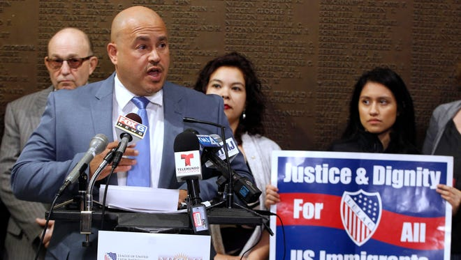 Milwaukee Ald. Jose Perez joins community organizations responding to President Trump's executive order of immigration policy during a news conference Wednesday at Milwaukee City Hall.