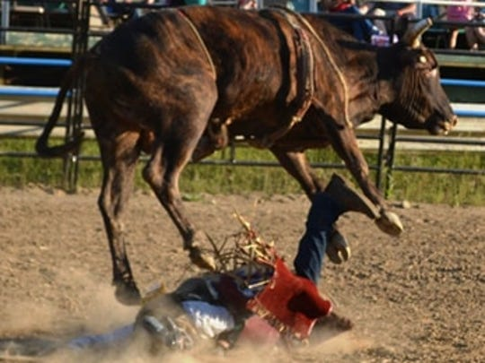 Logan Harter is stepped on for a second time by the bull he was riding at the Calhoun County Fairgrounds on June 29, 2018.