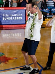 Notre Dame Fighting Irish coach Mike Brey celebrates after defeating the Wichita State Shockers in the championship game of the Maui Jim Maui Invitational at the Lahaina Civic Center.
