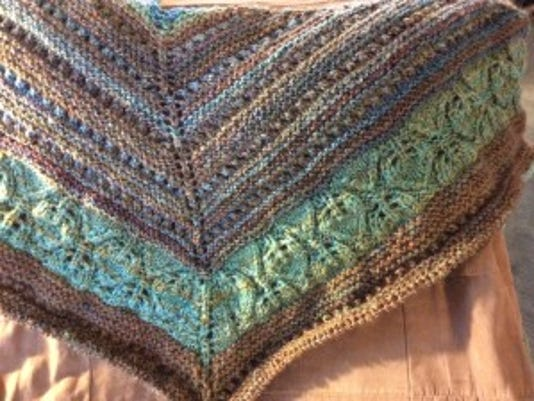 This photo is coming in upside down, but I  have a feeling if you see in on an iPhone or iPad, it looks right-side up. This is my shawl with yarn from Miners Hill Farm.