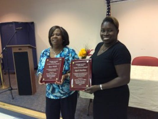 Rose Welsh, left, runs the Old Bridge Food Bank, and Ruth Mathiew, right, is president of the Old  Bridge CERT. They were honored last Saturday for their work.