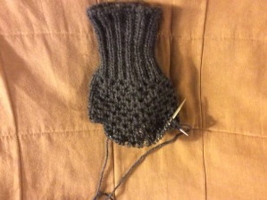 Mrs. T's first mitt is almost done.