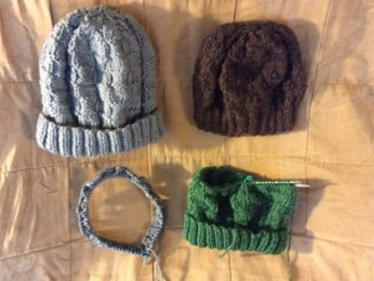 Yesterday, I finished the gray hat and the brown hat in the top row, and then I started the green and gray hats in the bottom row. The green one is nearly finished.