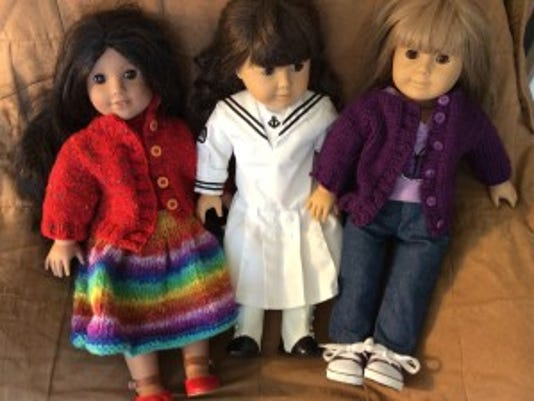 Last night, I sent these three dolls to the Butterfly Ministry for Girls. Josefina and Gwen (or doll #12) are wearing jacket sweaters I made from this pattern.