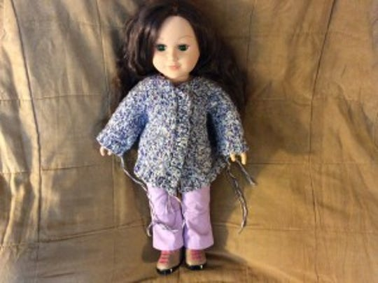 """I decided to keep the jacket I started for Gwen in the photo above. I made the raglan seams a little long and the sweater came out big. It's more like a swing coat then a jacket. My """"My Life"""" doll doesn't seem to mind, and I think she's slightly bigger than the American Girl dolls."""