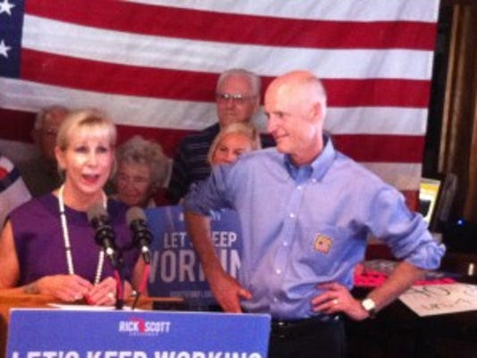 Gov. Rick Scott and his wife, Ann, at a campaign stop at Naples' Chrissy's Tavern & Bistro