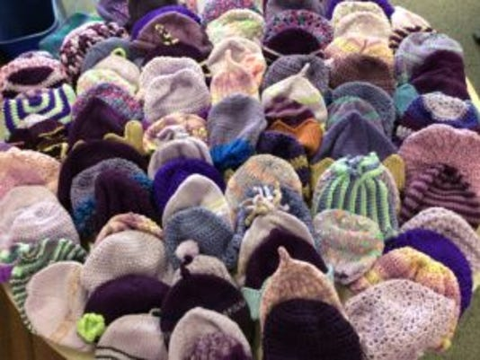 Since In Stitches in Person, we've received 91 more purple baby hats.