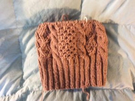 This is the Aran fisherman hat I started on Saturday. It's similar to several hats I made last winter, and it's going fast.