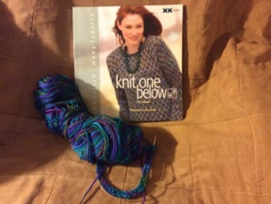 """I've always wanted to make the sweater on the cover of """"Knit One Below by Elise Duvekot."""" This weekend, I'm determined to make a doll version as a swatch, and then I'll make a version for myself."""