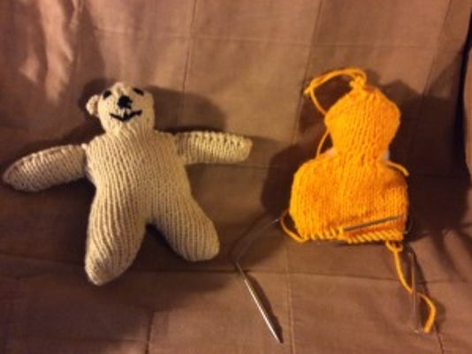 On the left is the first bear I made this year, and I did not follow a pattern for the head. It came out too small. On the right is my bear-in-progress, following the Two Hour Teddy Bear pattern from the Toronto Knit Cafe (see yesterday's post.) The head is coming out much better.