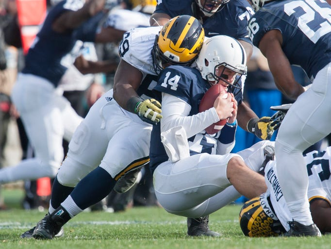 Michigan defensive tackle Willie Henry sacks Penn State