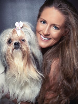 Keli Miller, pictured with Lexi, annually holds Bachelor & Bachelorette Auction for a Kaws to benefit local animal rescue organizations.