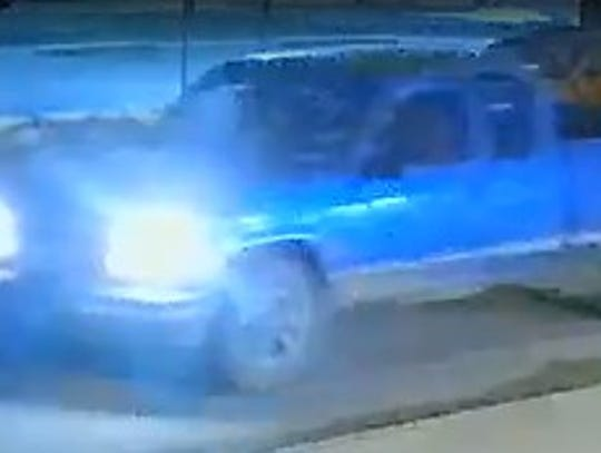 A still image of a blue pickup released by police.