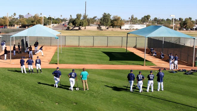 Brewers pitchers and catchers will have some cover if poor weather occurs.