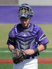 Wylie catcher Caleb Munton (25) walks back to the plate