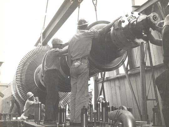 A turbine rotor for Unit 1 at the AEP Conesville Power Plant is loaded into the turbine housing during original plant construction. Unit 1 went online in 1957 and the plant is now celebrating its 60th anniversary.
