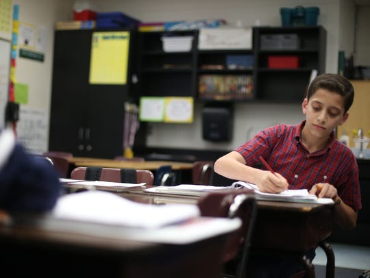 Mohammad Noor Alhendi, 12, works in his 5th-grade math