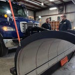 Collin Schifer, a sales representative for Henderson  Truck Equipment, talks Wednesday about the new snow plow recently bought at the City of Bucyrus Service Garage.