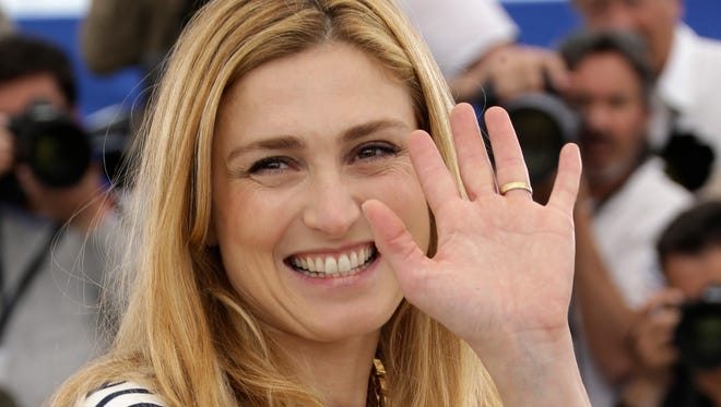French actress and producer Julie Gayet poses for photographers during a photo call for the film Comoara (Treasure), at the 68th international film festival, Cannes, southern France on May 21, 2015.
