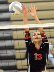 Pinckney's Kelsey Cornish goes up to block a shot against Saline.
