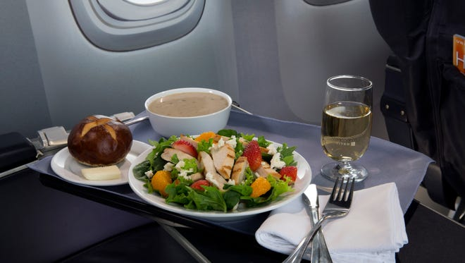 This product image provided by United Airlines shows a Strawberry Fields Salad, one of a variety of the airline's new first class food options.  The Chicago-based airline on Thursday, Aug. 21, 2014 announced that itís upgrading first class food options and replacing snacks with full meals on some of its shortest flights.