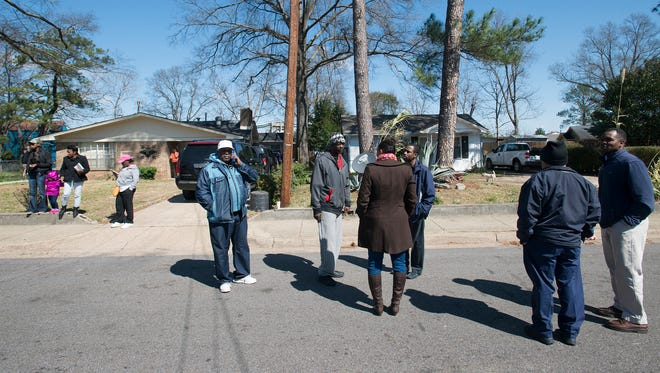 People gather outside 3237 McElvy Street where their was a police involved shooting death of Greg Gunn in Montgomery, Ala., on Thursday, Feb. 25 2016. Gunn was shot by a Montgomery police officer earlier that morning.