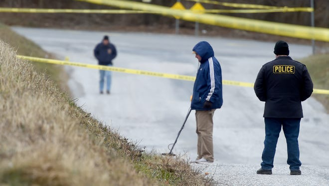 Police investigate near the crossroads of Hokes Mill Road and Old Salem Road in West Manchester Township after they found a man's body on fire early Thursday morning.